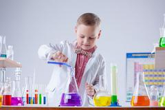 Inquisitive naturalist mixes reagents in flask Stock Photos