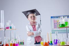 Funny boy posing as chemist in chemical laboratory Stock Photos