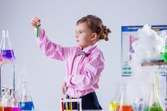 Stylish schoolgirl posing in chemistry lab - stock photo