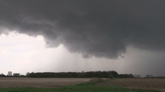 Severe thunderstorm and storm clouds approach with tornado warning in effect Stock Footage