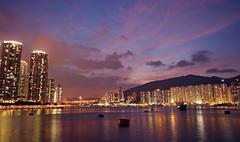 Hong kong at night and modern buildings Stock Photos