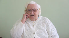 Old, deaf woman is using sign language. Stock Footage
