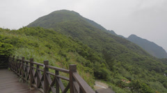Pan at the base of keelung mountain Stock Footage