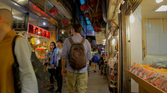 Foreign tourist walking on old street day Stock Footage