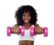 Stock Photo of Portrait of curly haired african fit woman