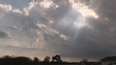 Crepuscular rays of sun through the clouds near sunset Stock Footage