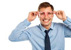 Man wearing heart shaped eye wear - stock photo