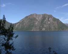 ROMSDALFJORDEN, NORWAY - pan fjord surrounded by high mountain peaks Stock Footage