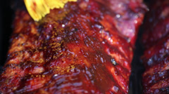 BBQ ribs Close up of Brushing on sauce Stock Footage