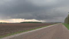 Severe thunderstorm and storm clouds approach with tornado warning in effect - stock footage