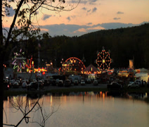 Carnival from Across pond at sunset zoom Stock Footage