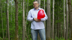 Man with red balloon episode 11 Stock Footage
