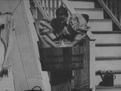 The Washer Woman And Naughty Boy - Circa 1898 Stock Footage