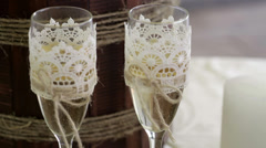 Two glasses with champagne standing on the table Stock Footage