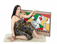 Stock Photo of Pleasant artist holding with left hand her abstract painting