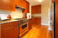 Stock Photo of beautiful new cherry kitchen with hardwood