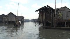 Criss-crossing boats on Makoko floating slum Stock Footage
