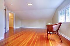 attic small room with hardwood floor - stock photo
