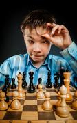 Nerd play chess Stock Photos