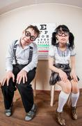 Two person wearing spectacles in an office at the doctor Stock Photos