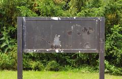 weathered old notice board - stock photo