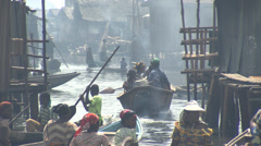 Bustling boats, busy people, smoke and Makoko waterway Stock Footage