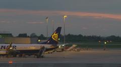 Passengers get off plane - timelapse (evening) Stock Footage