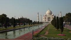People walking in front of the Taj Mahal, Agra, India Stock Footage