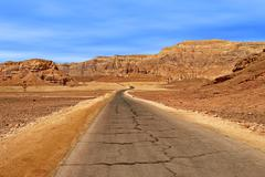 Road through red mountains in timna park. Stock Photos