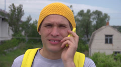 Young man traveler talking over the cellphone Stock Footage