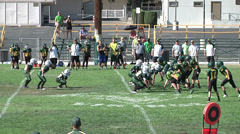 Youth League Football- Running Back Tackled Hard Stock Footage
