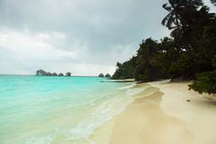 Storm on tropical island Stock Photos