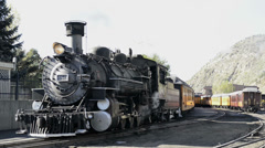 Steam Locomotive vents steam in the station-HD_P- 2238 Stock Footage
