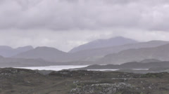 Peaks of the isle of Harris viewed from Isle of Bernera Outer Hebrides Scotland Stock Footage