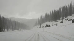 Point of view-Wolf Creek Pass Great Divide Colorado Rocky Mountains snow storm Stock Footage