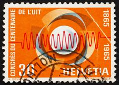 Stock Photo of Postage stamp Switzerland 1965 Symbol of Communications and Wave