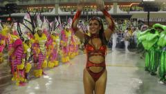 In a carnaval or carnival parade woman dances before camera Stock Footage