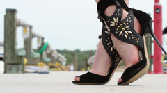 Fashion Footwear | close up of model in heels on boat dock Stock Footage
