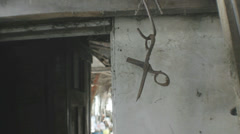 Creepy Rusty Scissors Hanging - 25FPS PAL Stock Footage
