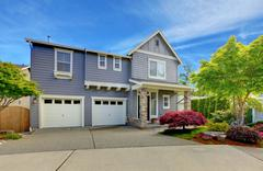 Grey american house with two garage doors. Stock Photos
