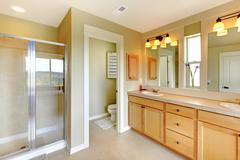 Beautiful classic bathroom with double sink and shower. Stock Photos