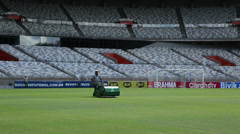 Brazil, World Cup, cutting grass in Minerao soccer stadium Stock Footage