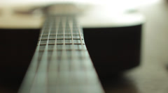 Tight focus dolly shot of guitar Stock Footage