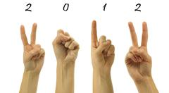 The number 2012 are shown via fingers in creative New Year greet - stock illustration