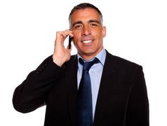 Charismatic businessman speaking on cellphone Stock Photos