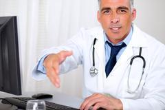Senior trustworthy doctor greeting - stock photo