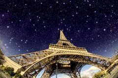 Stars and Night Sky above Eiffel Tower in Paris Kuvituskuvat