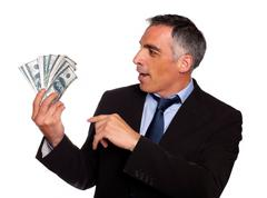 Ambitious executive looking dollars - stock photo