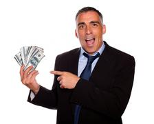 Ambitious executive holding cash money - stock photo