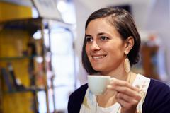 people in bar with woman drinking espresso coffee - stock photo